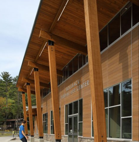 Bollback student life center exterior with skateboarder